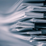 the extreamely close up  report paper stacking of office working document , retro color tone